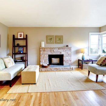 Light tones living room with a rocky background fireplace
